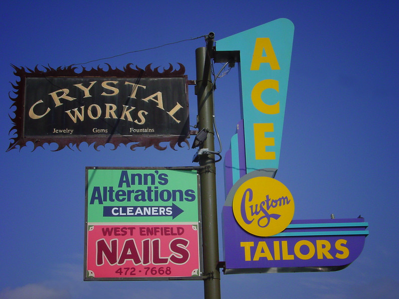 Signs, Lamar Boulevard and 12 Street, Austin, Texas.