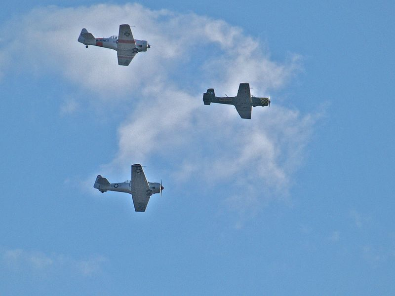 WWII Vintage Airplanes fly over northwest Austin on September 11, 2004.