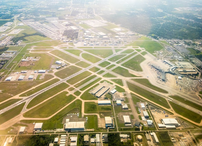 Aerial photo looking down on the William P. Hobby Houston Airport (HOU)  from the back row window seat after we turned crosswind, downwind, and departed the pattern.