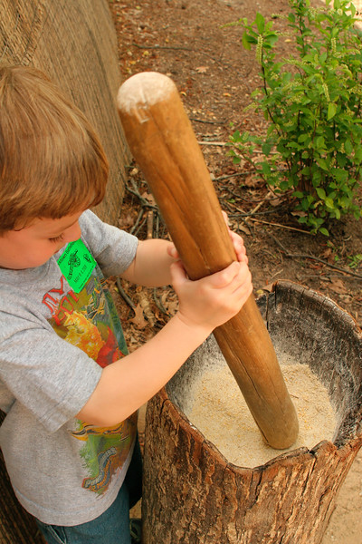 Grinding a little corn meal - Jamestown Settlement