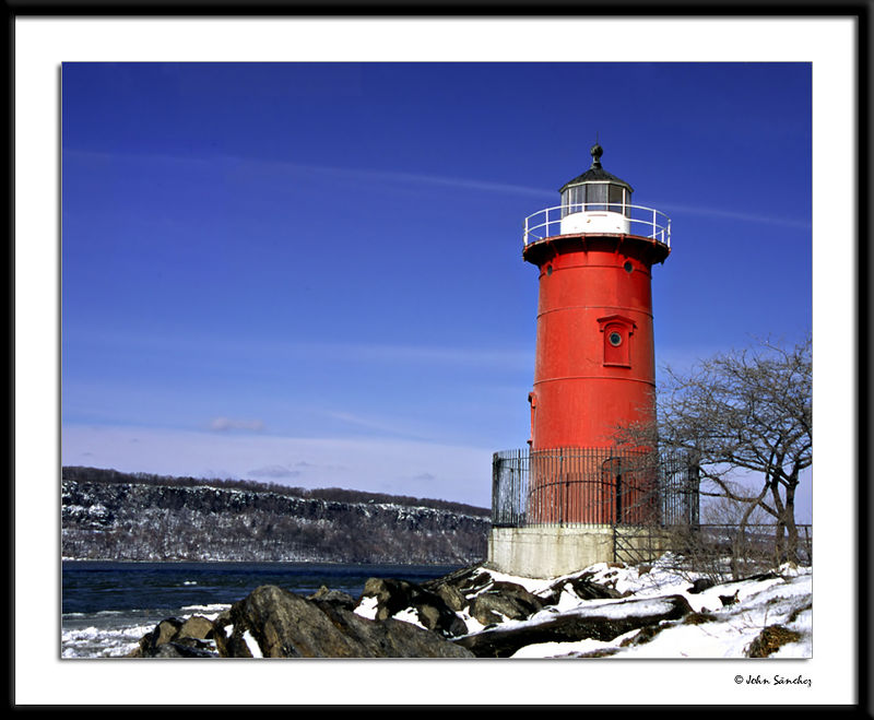 The Little Red Lighthouse and The Palisades in Winter.