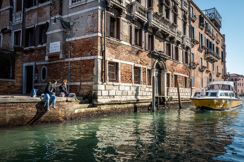 A couple and a boat in Venice