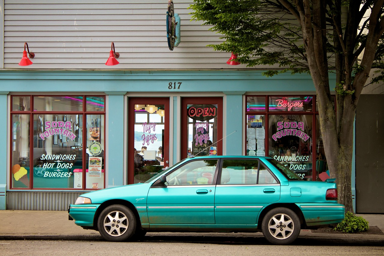 Nifty Fiftys Soda Fountain shop with color coordinated car.