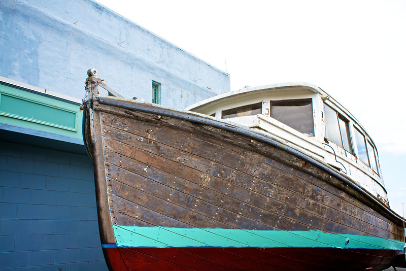 A weathered boat in the dock area of the port.