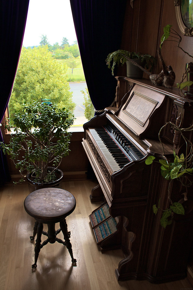 There is an old piano in the parlor near the Hotel front desk.