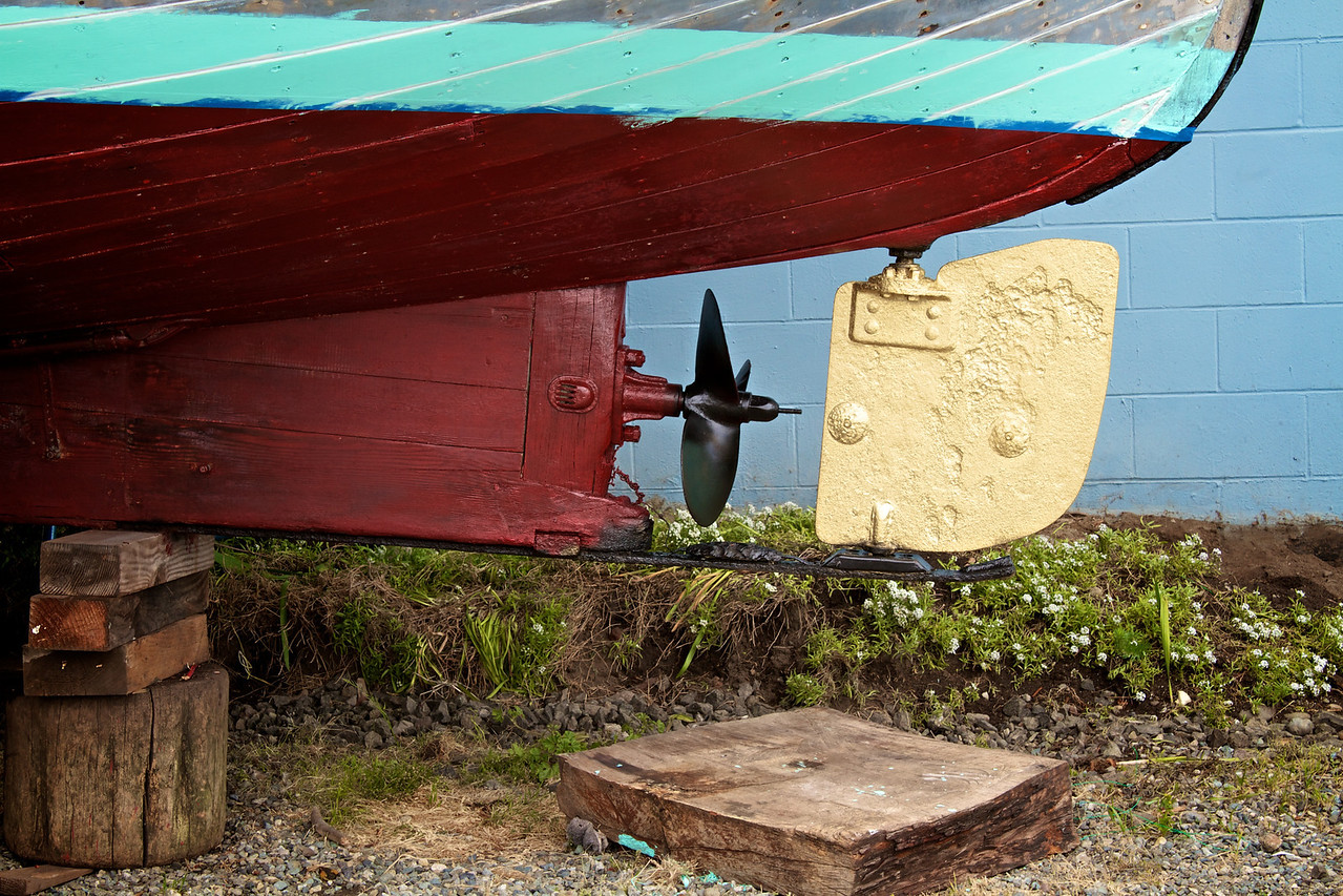 Gold rudder of a dry docked old boat.