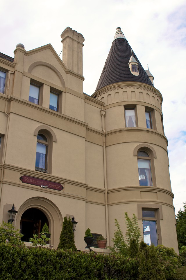 """Manresa Castle was originally completed in 1892 as the home of Charles and Kate Eisenbeis. Charles Eisenbeis was a prominent member of early Port Townsend (He was the first mayor), when the port was the most active in the pacific northwest. The twelve inch thick walls of his 30 room mansion were made of brick from Charles Eisenbeis's own brickworks. Locals came to call the building """"Eisenbeis Castle."""" In 1902 Charles Eisenbeis died, and the mansion was left empty when Kate remarried. In 1925 it was purchased to function as a vacation home for nuns. In 1927 it was purchased by Jesuits who turned it into a training college and renamed it Manresa Hall. It is the jesuits who built the large extension to the original building and covered the brick walls of the original section to keep it more in line with the new wing. In 1968 the Jesuit's left and it became a hotel."""