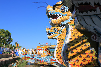 Row of Dragon boats lined up on Huong (Perfume) River
