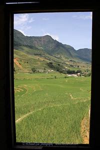 View through shope window near Tan Van Village