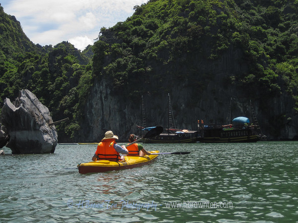 Kayaking through Halong Bay