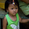 Little girl that doesn't smile, in community around Giac Vien Pagoda