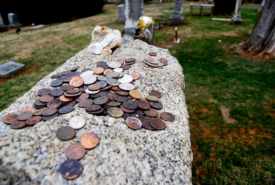 Coins are placed on John Mosby's tombstone in Warrenton.