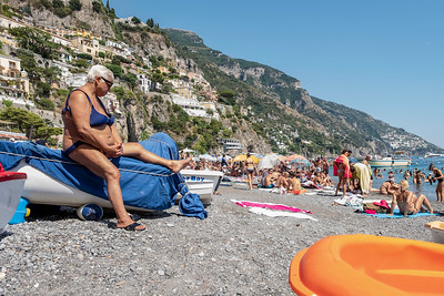 I was sitting with my niece waiting for the ferry from Positano to Selerno with camera on my lap.  I noticed this woman, who don't you just know has been owning this beach this the day she was born...