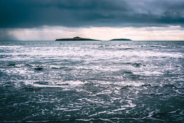 Storm approaching Ynys Gwylan, gull islands, N Wales.
