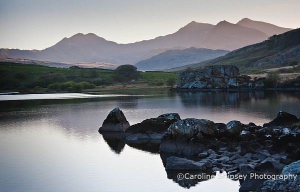 End of the day at  Llynnau Mymbyr, set amongst Snowdonia's highest peaks, are also known as the Capel Curig Lakes and are around 3/4 mile long, with a depth of 30 feet. The lakes are situated just outside the village of Capel Curig on the road to the Llanberis Pass (A4086). A delta halfway along the north shore, dissects the lakes.