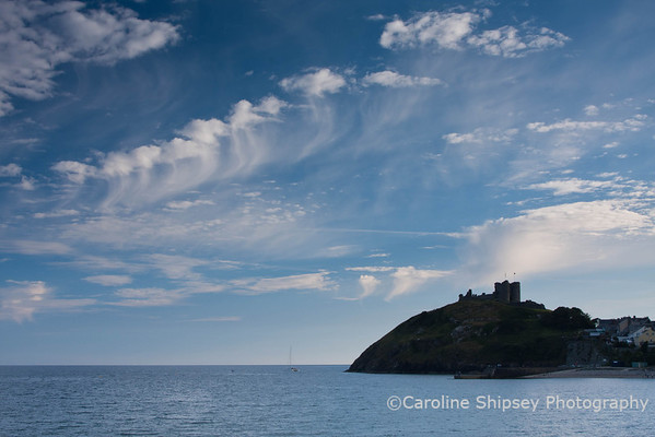 Criccieth Castle in evening light.  The castle sits on a hill overlooking the town between two beaches,  in Gywnedd, North West Wales.  <br /> This photo is as much about the clouds as the location, if not more so!