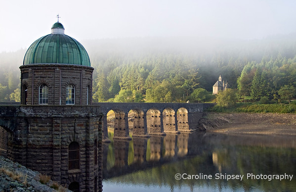 The Foel Tower, Careg-Ddu, 15th September 2006  -  is the starting point of the 73 mile journey of the water from the Elan Valley to Birmingham. It was built in a style which, like many of the other structures of the waterworks scheme, has become known as 'Birmingham Baroque'. This elegant stone tower houses a system of valves and cylinders which can be raised and lowered hydraulically to draw water off from the reservoir at various depths as required. This water is then directed into the start of the aqueduct, controlled by valves.