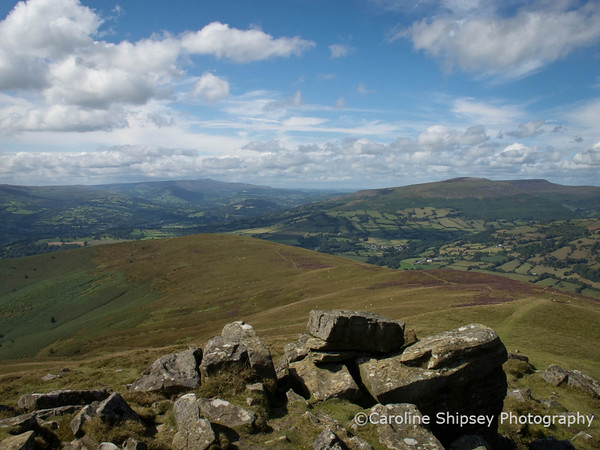 View from the top of Sugar Loaf looking towards Pen Y Fan in the far  distance, just left of centre, with the Black Mountains to the right.