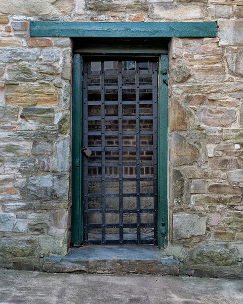 This is a second jailhouse courtyard door that exits to an alley.