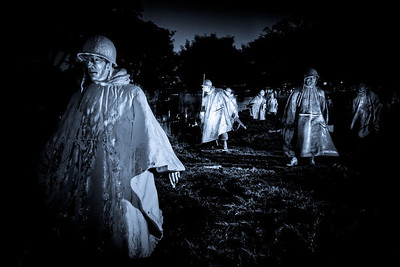 War Ghosts The Korean War Memorial was eerie in the dark and rain. The fact the statues had rain parkas on only added to the realism and drew you in to their moment.