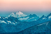 North Cascades (Mount Baker, Mount Degenhardt, and parts of Crater Peak and Jack Mountain), from Slate Peak, at sunrise.  Mount Baker, over 50 miles away, is just starting to break earth's shadow.