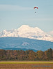 Self-propelled parasailing, with Mount Baker as backdrop
