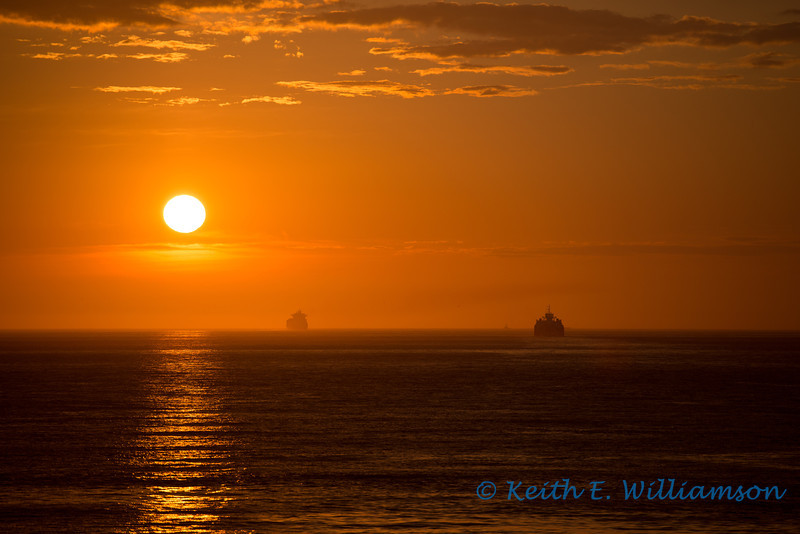 Ships heading out the Strait of Juan de Fuca at sunset