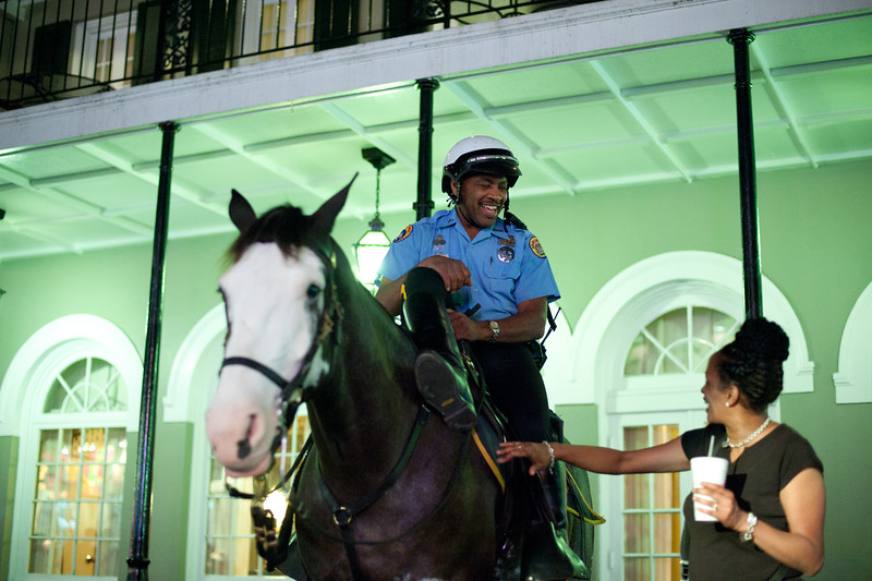 Equestrians and pedestrians in the French Quarter, NOLA