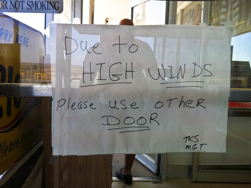 "Sign on a door at Stuckey's in NM: ""Due to HIGH WINDS Please use other DOOR TKS MGT"""