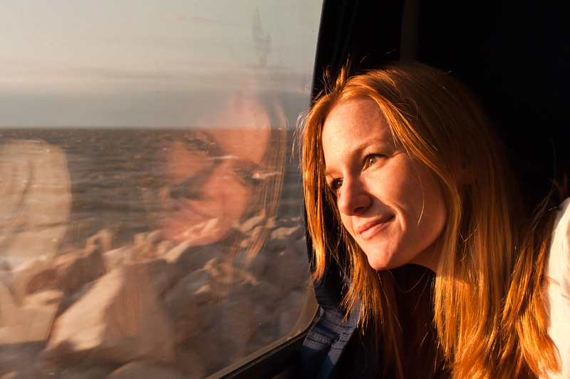 Marisa watching a Lake Pontchartrain Sunset through the window of our Amtrak train.