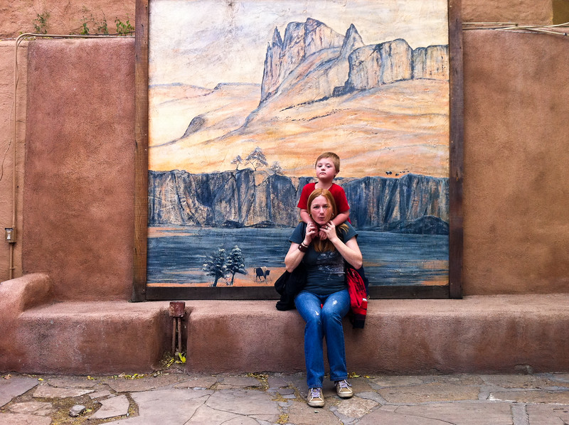 Marisa and Vincent in front of some art in Old Town, Albuquerque, NM