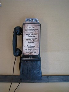 Dictate Your Telegram  An ancient telephone-like device aboard an old train coach.