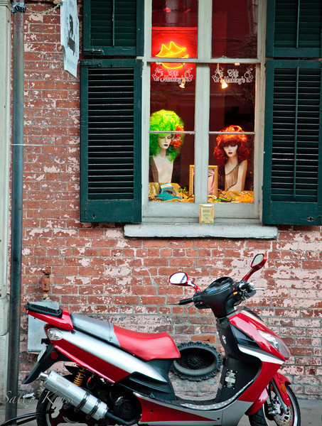 Two mannequins keeping watch on a scooter outside the salon where they reside in the French Quarter, New Orleans.