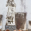 A damaged statue in a pile of rubble in the St. Louis Cemetery #1, New Orleans.