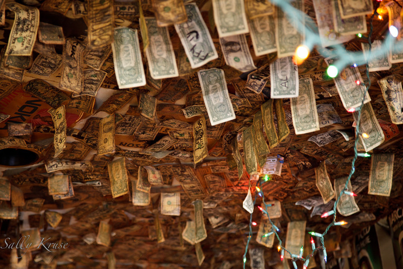 The ceiling of Kelly's Pub on Decatur street, decorated with dollar bills and twinkle lights.