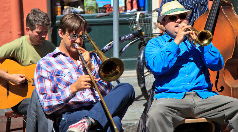 The horn section of a band performing on Royal Street in the French Quarter, New Orleans.