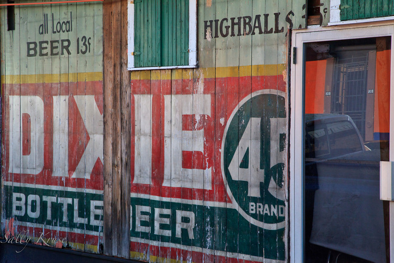 A building located in the Marigny/Bywater district, New Orleans, with an interesting paint job advertising Dixie Bottled Beer and Highballs.