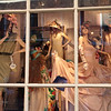 Window dressing.  Peering through the front window into an apparel shop located in the French Quarter, New Orleans.
