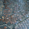 Pennies laid out and cemented into a section of sidewalk on Royal Street in New Orleans.