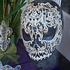 A very intricately woven and beaded mask in a shop window in New Orleans.