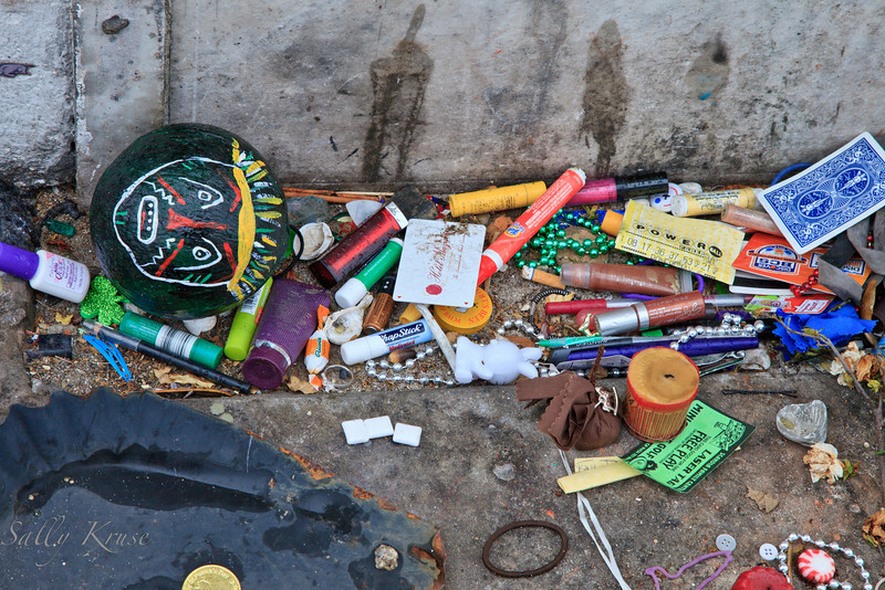Offerings from followers of the voodoo culture at the base of the reputed tomb of Marie Laveau in the St. Louis Cemetery #1, New Orleans.