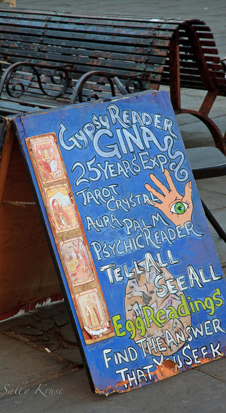 Gypsy Reader Gina's sandwich board sign advertising the future in New Orleans, outside Jackson Square.