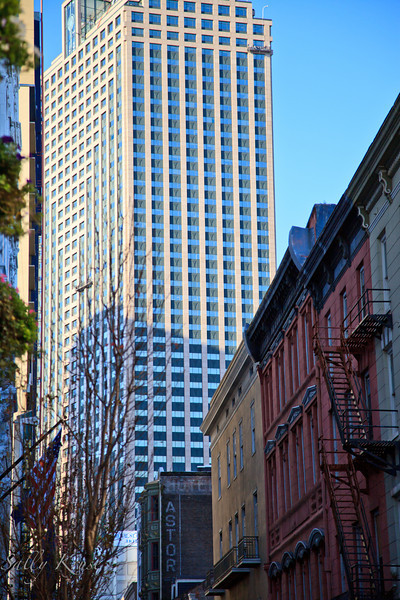 A mix of old world and modern buildings share the same block in New Orleans.