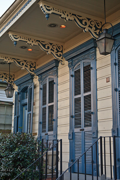 A quaint home with shuttered doors and tons of gingerbread in the Marigny/Bywater district, New Orleans.