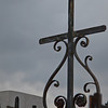 A wrought iron cross in the St. Louis Cemetery #1 on Basin Street in New Orleans.