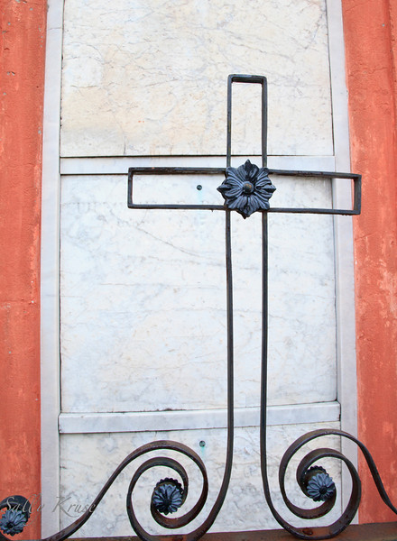 A wrought iron cross decorating a tomb in the St. Louis Cemetery #1, New Orleans.