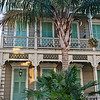 A lovely home, complete with beads in the palm tree located on Royal Street in the French Quarter, New Orleans.