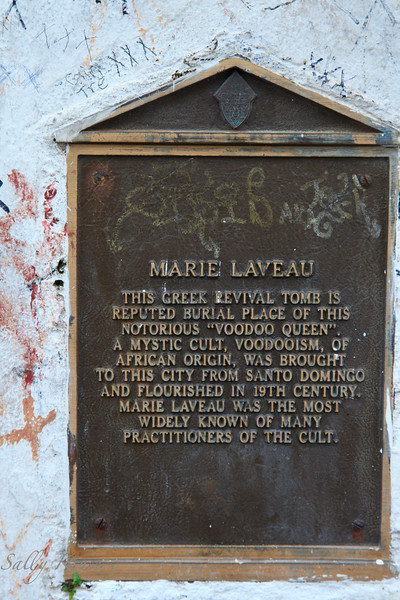 A plaque on the front of a tomb in the St. Louis Cemetery #1, New Orleans, declaring this to be the tomb of Marie Laveau.