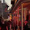 The scene on Bourbon Street comes alive at night.  Lined with bars, restaurants and clubs, revelers overindulge in drink and fun.