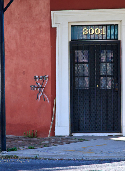 """""""Katrina X"""" Rescuers painted symbols on the outsides of buildings to indicate when it had been searched and by whom.  This home located in the Marigny/Bywater district, duplicated the inspection symbol in metal as a permanent reminder."""